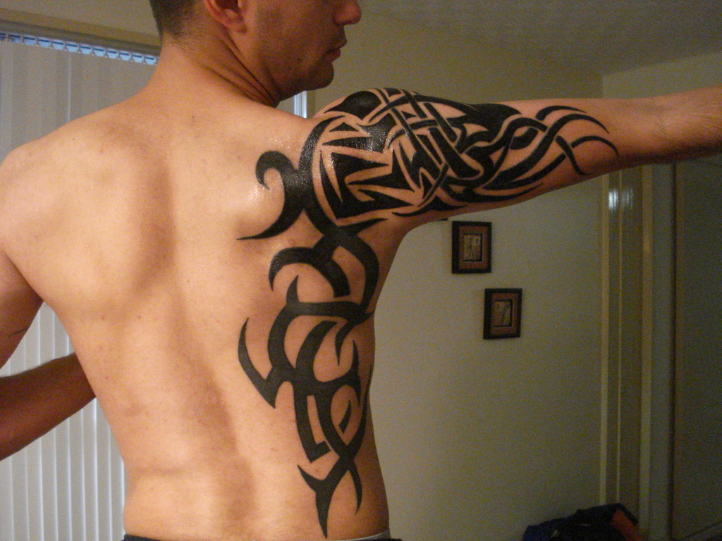 http://tattoolovers.files.wordpress.com/…-arm-tattoo.jpg